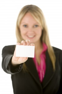 2169140-businesswoman-holding-blank-business-card